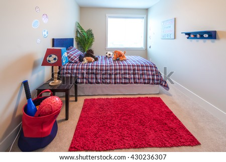 Modern comfortable, nicely decorated children bedroom with some toys. Interior design.