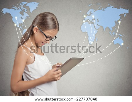 Modern communication technology mobile pad computer high tech, wide web connection concept. Girl holding portable pc connected browsing internet worldwide world map background. 4g data plan provider - stock photo