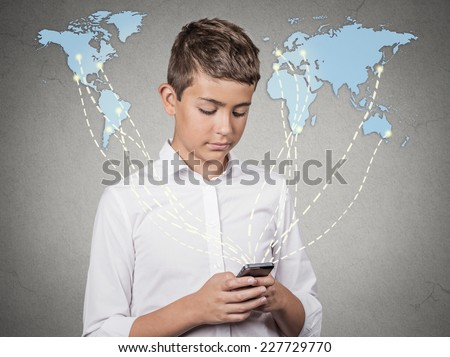 Modern communication technology mobile phone high tech, wide web connection concept. Teenager boy holding smartphone connected browsing internet worldwide world map background. 4g data plan provider - stock photo