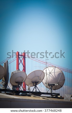 Modern communications satellite dishes, for Technology and global world information worldwide - stock photo