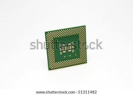 Modern computer CPU chip with white background.