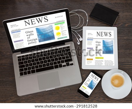 modern computer devices laprop, tablet and phone with news site screen  - stock photo