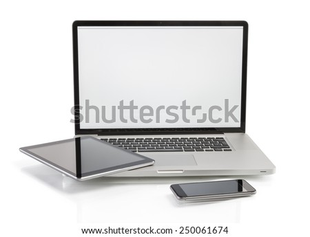 Modern computer devices - laptop, tablet pc and smart phone with copy space on screen - stock photo