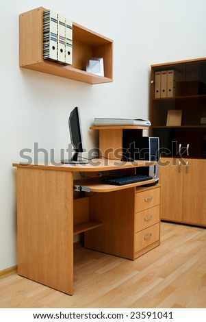 Modern computer on a wooden table at office - stock photo