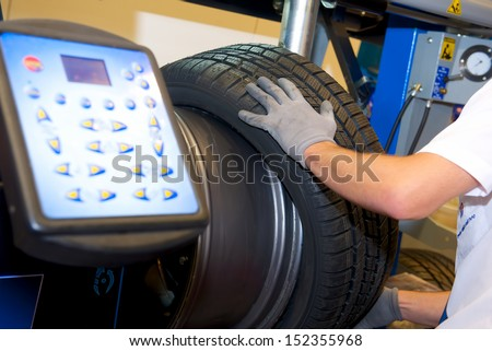 modern computer stand balancing of wheels - stock photo