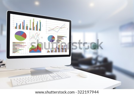 Modern computer with keyboard and mouse on table showing charts and graph against office background in blue tone, Analysis Business, Statistics Concept. - stock photo