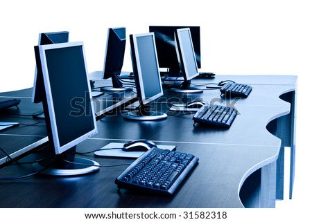 modern computers with LCD screens on desks isolated with clipping path - stock photo