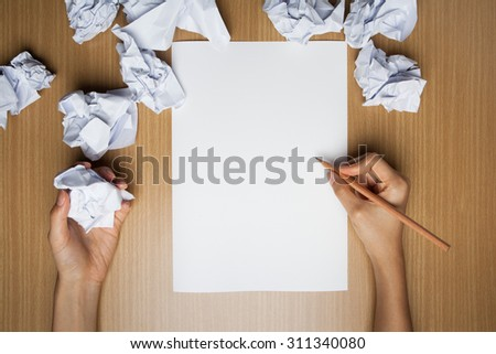 modern concept flat design on creative process and idea research | Flat creative illustration on hands of a man thinking about idea with sheet of paper and pencil | Creativity crisis solution - stock photo