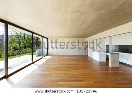 modern concrete house with hardwood floor, wide open space