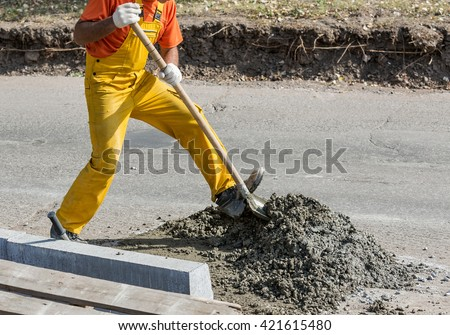 Modern construction is complete without manual labor - stock photo
