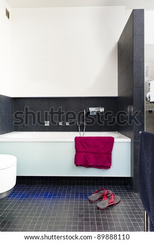 Modern contemporary bathroom design with towel - stock photo