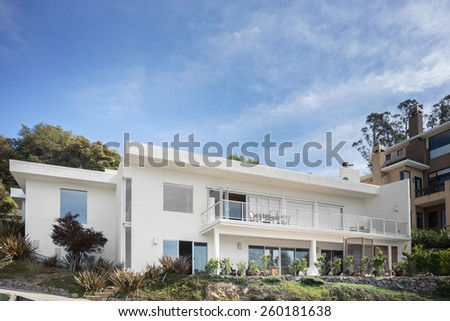 Modern contemporary home with blue sky. - stock photo