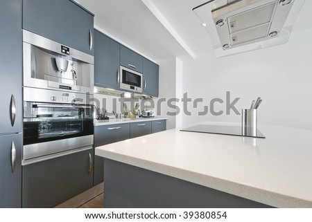 modern contemporary kitchen with built in appliances including coffee machine - stock photo