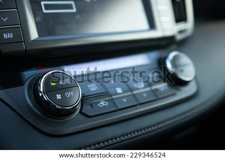 Modern control panel of a car - temperature & climate buttons
