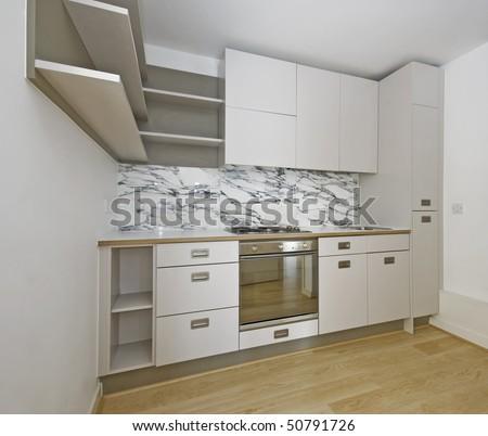 modern corner shape kitchen unit in beige color - stock photo