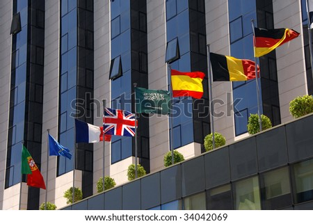 Modern corporate building with flags - stock photo