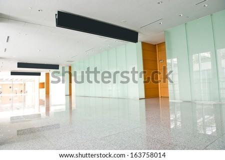 modern corridor in office centre. - stock photo