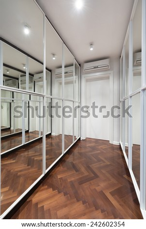 Modern corridor interior with mirror wardrobe doors  - stock photo
