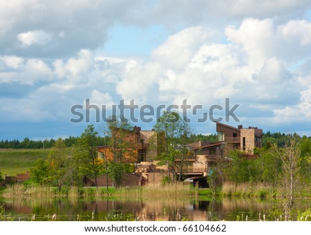 modern cottages on the lake - stock photo