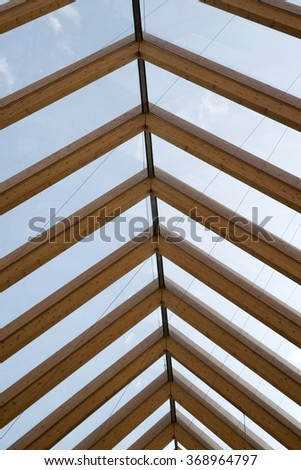 Modern cover made of laminated beams and glass plates