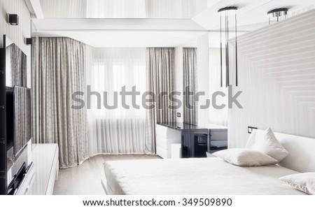 Modern cream bedroom interior - stock photo