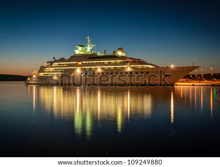 Modern cruise liner in the harbor at night - stock photo