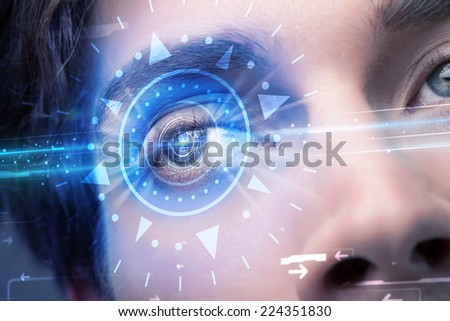 Modern cyber man with technolgy eye looking into blue iris - stock photo