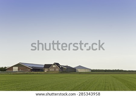 Modern dairy farm building,house and roofed silo for manure found in the countryside in Drenthe, The Netherlands. Photo taken in May 2015. - stock photo