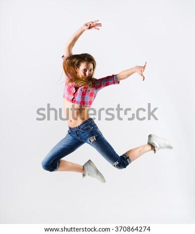Modern dancer girl on grey - stock photo