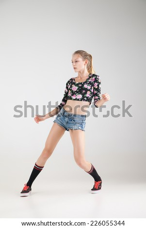 modern dancer poses in front of grey studio background - stock photo