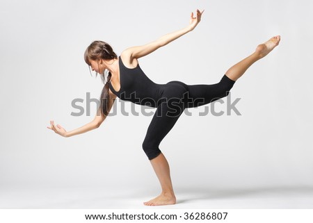 modern dancer poses in front of the white wall - stock photo