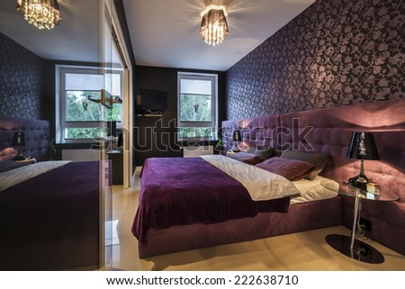 Modern, dark interior design: bedroom with king size bed - stock photo