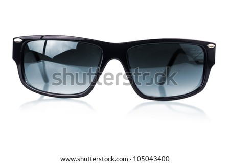 Modern dark sunglasses with a black frame  on a white background with reflections - stock photo