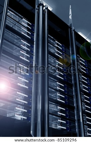 Modern Data Center with Lens Flare. Servers Racks - Dark Metal, Glass and Chrome Elements Racks. Elegant Modern Data Center. Hosting Theme 3D Render Illustration.