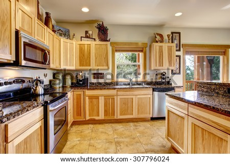 Modern day kitchen with nice tile floor and great counter tops. - stock photo