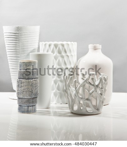 modern decoration vases with reflection on a beautiful composition