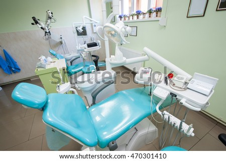 Modern dental chair with accessories to it, drill, photopolymer lamp, equipment for restorative dentistry in dentist's office