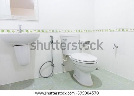 Modern design home bathroom toilet and sink White colur sanitary ware in  the bathroom. Modern Design Home Bathroom Toilet Sink Stock Photo 595004570