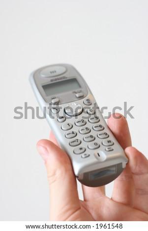 modern design home phone in hand - stock photo