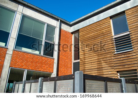 Modern design house with bricks and wooden facade - stock photo