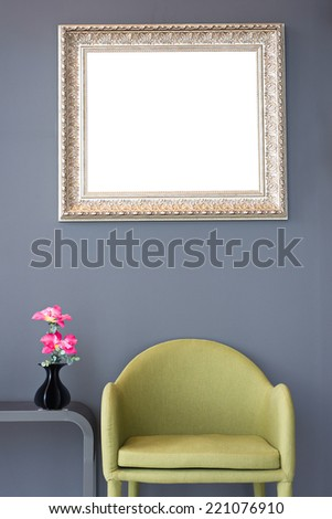 Modern design of lounge room green chair pink flowers vintage photo gold frame retro with clipping path. - stock photo