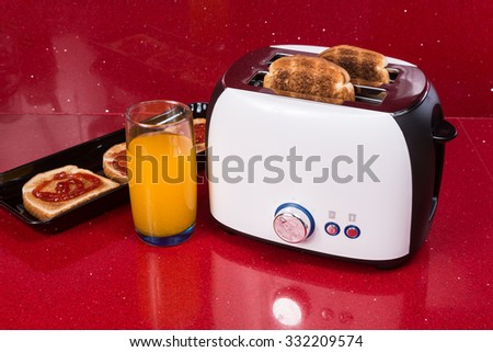 Modern design of the bread toaster in the  red kitchen interior - stock photo