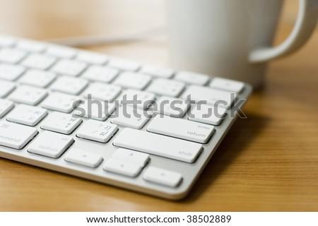 Modern design white keyboard in office environment - stock photo