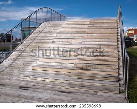 Modern design wooden sun bathing relax deck resort by the ocean - stock photo