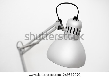 Modern designed gray metal office table lamp inspires the creative succesful work in the office on isloated white background - stock photo