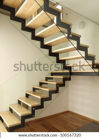 Modern designed stairs made with wood and glass - stock photo