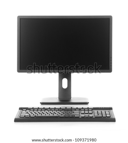 Modern desktop computer with wireless keyboard - stock photo
