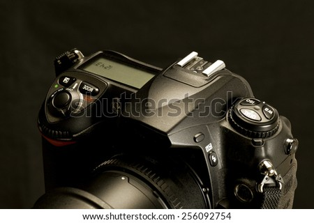 Modern Digital Camera Controls On Black Background - stock photo