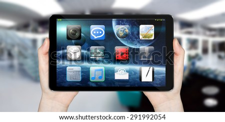 Modern digital tactile tablet on blured office background 'elements of this image furnished by NASA' - stock photo