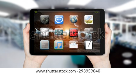 Modern digital tactile tablet on blured office background 'elements of this image furnished by NASA'